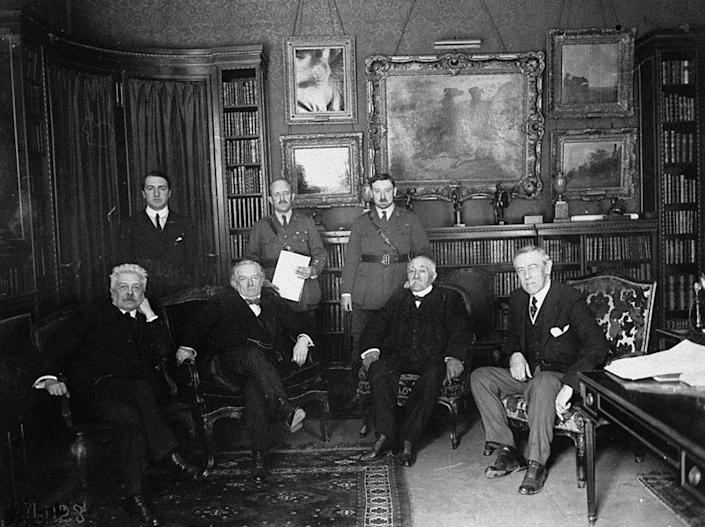 1919 Peace Conference attendees (seated, L-R) Italian Premier Vittorio Orlando, British Prime Minister David Lloyd George, French Premier Georges Clemenceau, U.S. President Woodrow Wilson meeting in Paris prior to the signing of the Versailles Treaty. | US Army Signal Corps/The LIFE Picture Collection—Getty Images