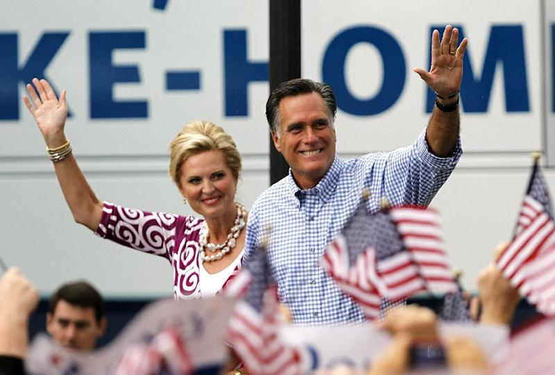 Republican presidential candidate and former Massachusetts Gov. Mitt Romney, right, waves as he arrives with his wife Ann at a campaign rally, Sunday, Oct. 7, 2012, in Port St. Lucie, Fla. (AP Photo/Lynne Sladky)