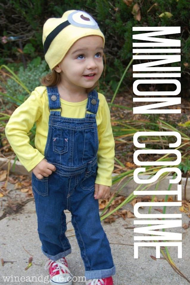 """<p>The hat is the most important part of a DIY Minion costume. If you have that and a yellow top and overalls, you're pretty much set. </p><p><strong>Get the tutorial at <a href=""""https://www.wineandglue.com/minion-costume-with-easy-minion-hat/"""" target=""""_blank"""">Wine And Glue</a>. </strong> </p><p><strong><a class=""""body-btn-link"""" href=""""https://www.amazon.com/Kidscool-Little-girls-Lining-Overalls/dp/B06W53MXCD/ref=sr_1_15?tag=syn-yahoo-20&ascsubtag=%5Bartid%7C10050.g.28305850%5Bsrc%7Cyahoo-us"""" target=""""_blank"""">SHOP OVERALLS</a><br></strong></p>"""