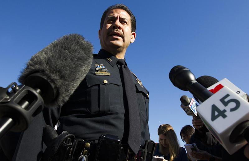 Harris County Sheriff Adrian Garcia talks to the media Sunday, Nov. 10, 2013 outside a home where two people were killed and at least 20 othersinjured late Saturday when gunfire erupted during a house party in the Cypress area. The shooting broke out about 11:15 p.m. in the 7300 block of Enchanted Creek Drive, in Houston. (AP Photo/Houston Chronicle, J. Patric Schneider)