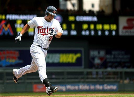 Minnesota Twins' Oswaldo Arcia runs on his three-run home run against the Miami Marlins during the fourth inning in the first baseball game of a doubleheader on Tuesday, April 23, 2013 in Minneapolis. The Twins won the game 4-3. (AP Photo/The Star Tribune, Jerry Holt)