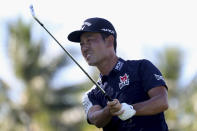 CORRECTS TO KEVIN NA NOT KEITH MITCHELL - Kevin Na follows his drive on the 11th tee box during the third round at the Sony Open golf tournament Saturday, Jan. 16, 2021, in Honolulu. (AP Photo/Marco Garcia)