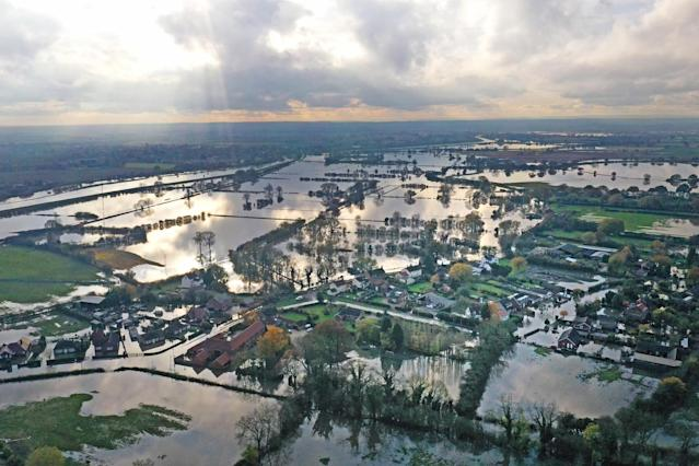 "In November, parts of the north of England were devastated by severe flooding. The village of Fishlake, near Doncaster, South Yorkshire, was one of the worst places affected, with many residents reluctant to leave their homes despite council warnings. Experts called the flooding a ""once-in-60-years"" weather event (Picture: PA)"