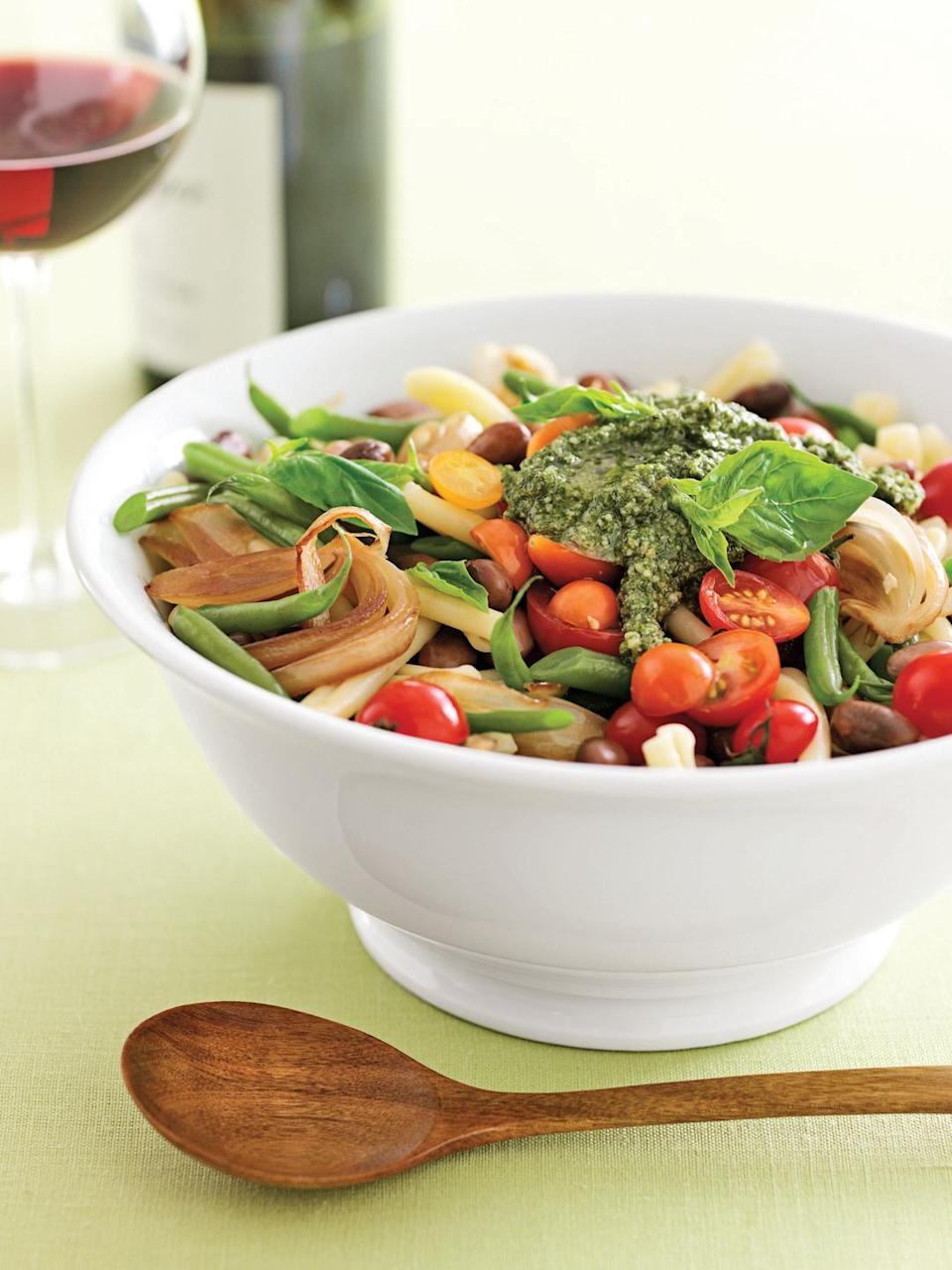 """<p>Use fresh, locally grown ingredients for very tasty fare. Pesto adds robust flavor to this one-dish pasta supper. </p><p><strong><a href=""""https://www.countryliving.com/food-drinks/recipes/a1046/pasta-e-fagioli-pesto-3152/"""" rel=""""nofollow noopener"""" target=""""_blank"""" data-ylk=""""slk:Get the recipe."""" class=""""link rapid-noclick-resp"""">Get the recipe.</a></strong></p>"""