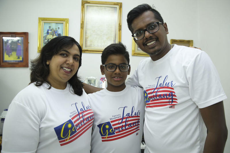 Ervin Devadason and his parents, Edward Devadason and Thayanee Rajamanoharan, pose for a photo at their house in Shah Alam June 23, 2018. — Picture by Yusof Mat Isa