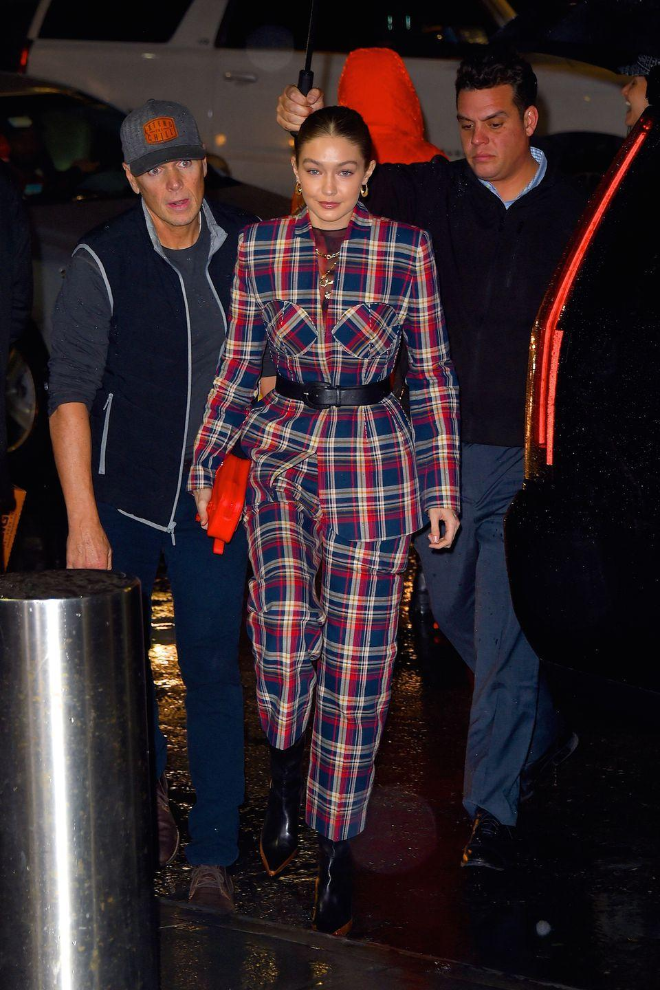 """<p>In a tartan suit by Esau Yori, ankle boots by <a href=""""https://www.farfetch.com/shopping/women/wandler-bente-ankle-boots-item-14119527.aspx"""" rel=""""nofollow noopener"""" target=""""_blank"""" data-ylk=""""slk:Wandler"""" class=""""link rapid-noclick-resp"""">Wandler</a>, earrings by Lili Claspe, and a pouch by Louis Vuitton. </p>"""