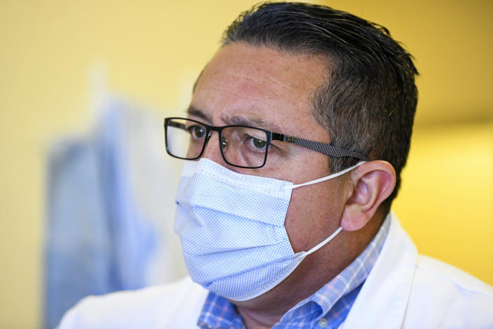 Dr. Ricardo Maldonado, who leads the pandemic response team at East Alabama Medical Center, says that he will spend his Christmas Day working in the COVID-19 unit Thursday, Dec. 10, 2020, in Opelika, Ala. (AP Photo/Julie Bennett)