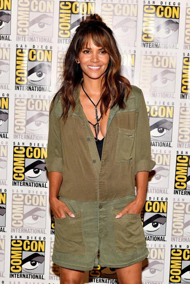 "<p>While making the promo rounds at Comic-Con, Berry flashed her megawatt smile and donned this <a href=""https://www.yahoo.com/beauty/halle-berrys-hair-point-chugged-whiskey-comic-con-014604817.html"" data-ylk=""slk:half-up, half-down hairdo"" class=""link rapid-noclick-resp newsroom-embed-article"">half-up, half-down hairdo</a>, which she referred to as ""on fleek."" (Photo: Dia Dipasupil/Getty Images) </p>"