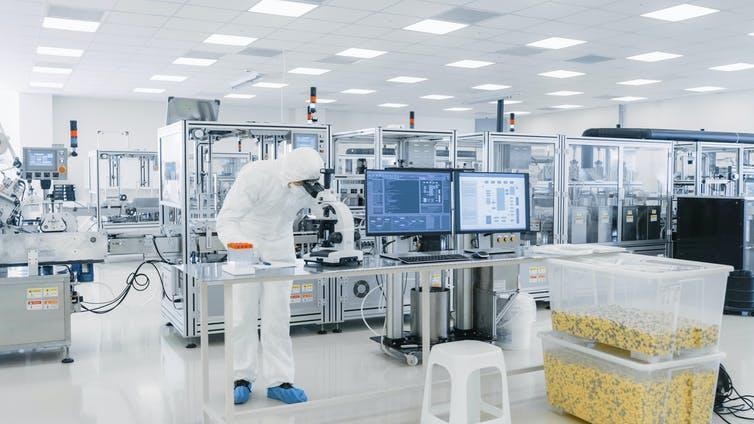 A technician at work in a lab developing vaccines