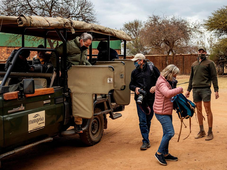 Tourists wearing face masks during a guided safari tour near Pretoria, South Africa (AFP via Getty Images)