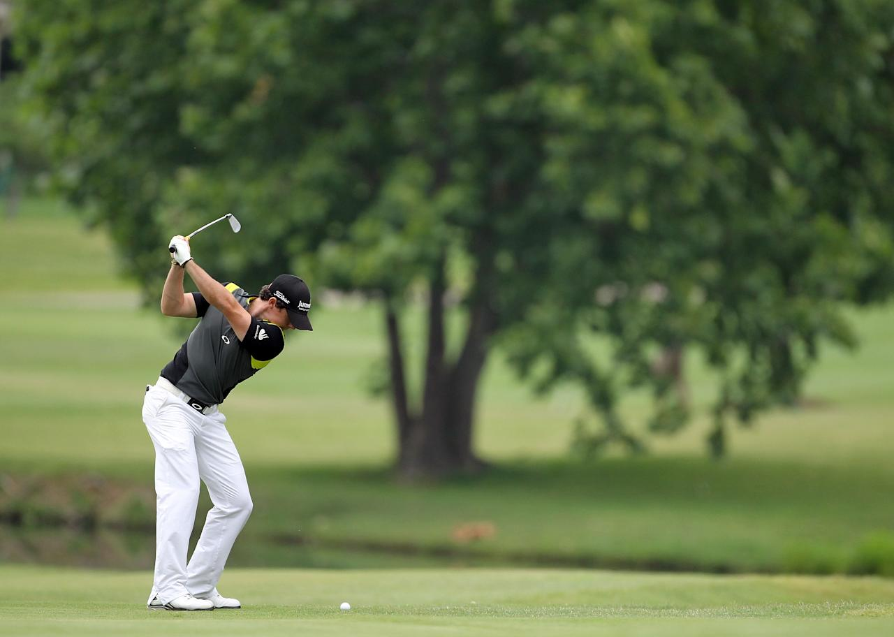 MEMPHIS, TN - JUNE 10:  Rory McIlroy of Northern Ireland hits his second shot on the par 4 9th hole during the final round of the FedEx St. Jude Classic at TPC Southwind on June 10, 2012 in Memphis, Tennessee.  (Photo by Andy Lyons/Getty Images)