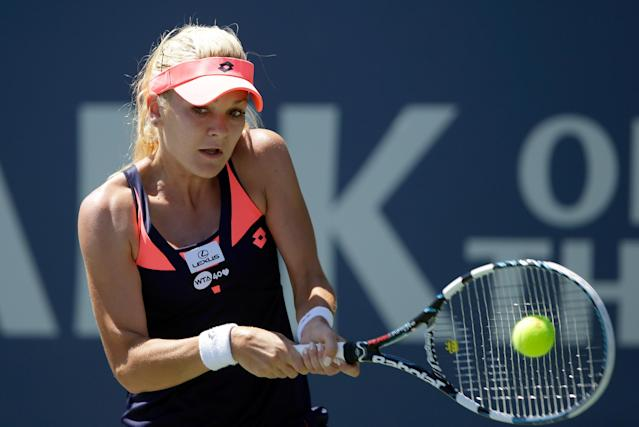 STANFORD, CA - JULY 28: Agnieszka Radwanska of Poland returns a shot to Dominika Cibulkova of Slovakia during finals on Day 7 of the Bank of the West Classic at Stanford University Taube Family Tennis Stadium on July 28, 2013 in Stanford, California. (Photo by Ezra Shaw/Getty Images)