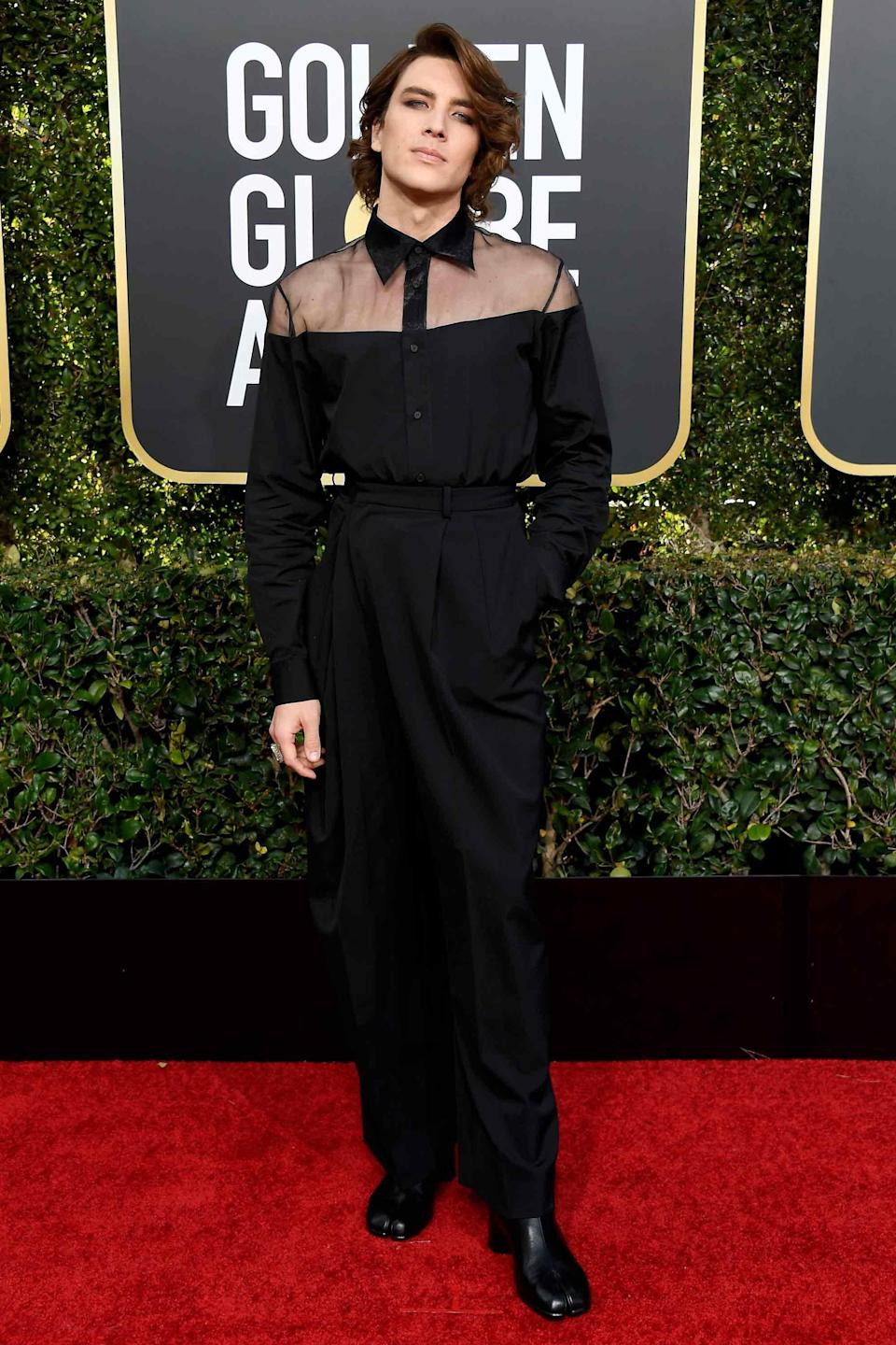 We'll have to fact-check, but we're <em>pretty</em> sure this is the first time Margiela's Tabi boots have hit the Golden Globes red carpet.