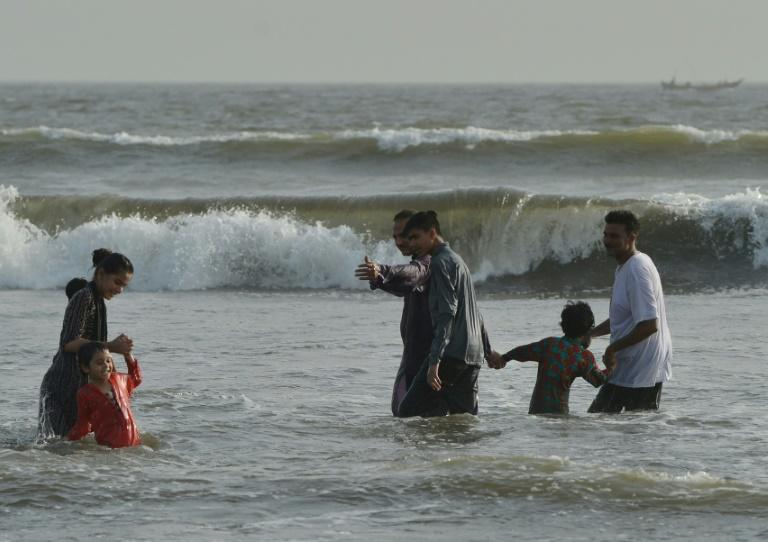Pakistanis cool off at a beach as the country's  largest city, Karachi, swelters in temperatures of 42 degrees Celsius