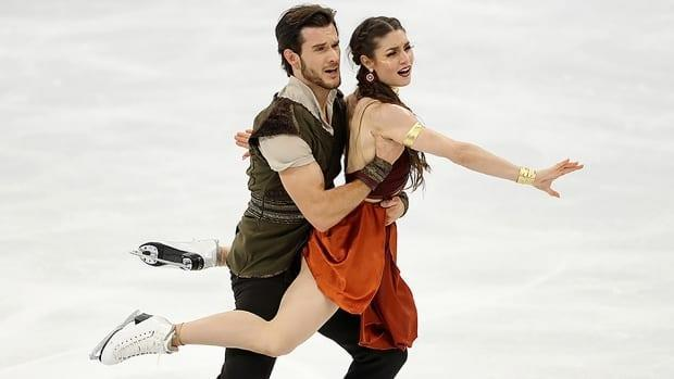 Canadian ice dancers Laurence Fournier Beaudry, right, and Nikolaj Sorensen scored 76.64 points Saturday and occupy second spot behind Italy's Charlene Guignard and Marco Fabbri (82.05) after the rhythm dance at the Lombardia Trophy figure skating competition in Bergamo, Italy. (Linnea Rheborg/Getty Images/File - image credit)