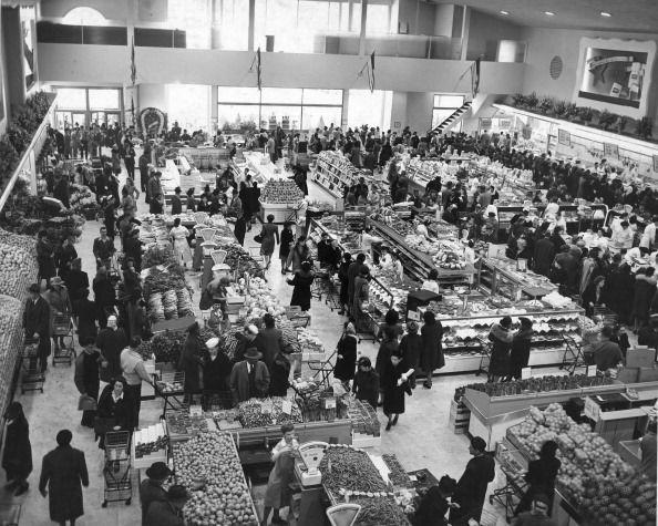 """<p>As grocery stores became more profitable in the '30s, more chains opened up nationwide. By the time the '50s rolled around, there was a fierce competition in the marketplace and <a href=""""https://clickamericana.com/topics/culture-and-lifestyle/scenes-from-grocery-stores-supermarkets-of-yesteryear"""" rel=""""nofollow noopener"""" target=""""_blank"""" data-ylk=""""slk:retailers enlisted advertising companies"""" class=""""link rapid-noclick-resp"""">retailers enlisted advertising companies</a> to create flashy ads that would set themselves apart.</p>"""