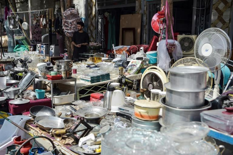 Kabul's bazaars are packed full of items offloaded by Afghans who have fled the country (AFP/WAKIL KOHSAR)