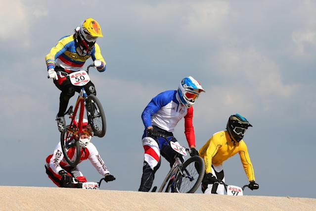 LONDON, ENGLAND - AUGUST 09: Emilio Andres Falla Buchely (L) of Ecuador clears a jump with the field during the Men's BMX Cycling Quarter Finals on Day 13 of the London 2012 Olympic Games at BMX Track on August 9, 2012 in London, England. (Photo by Phil Walter/Getty Images)