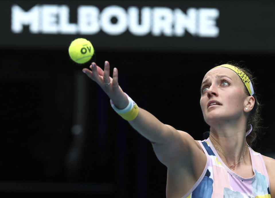 Petra Kvitova of the Czech Republic serves to Spain's Paula Badosa during their second round singles match at the Australian Open tennis championship in Melbourne, Australia, Wednesday, Jan. 22, 2020. (AP Photo/Dita Alangkara)