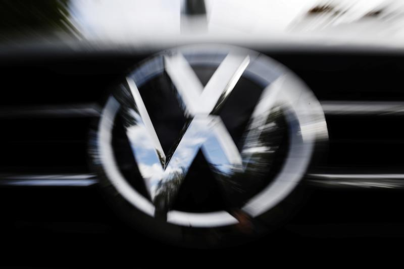 The VW logo is seen at the site of the first hearing of a consumer group's class action suit on behalf of Volkswagen owners against VW over the diesel emissions cheating scandal, at the Higher Regional Court in Braunschweig, Germany, September 30, 2019. REUTERS/Michele Tantussi