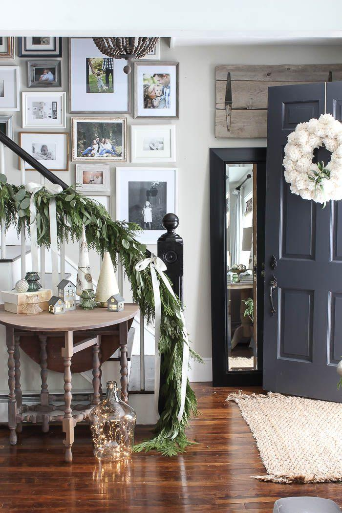 """<p>For a timeless look, drape garland instead of wrap it around the banister. Here, a mixture of evergreen and eucalyptus coupled with delicate white bows really brings the elegance. </p><p><em>See more at <a href=""""https://roomsforrentblog.com/2018/11/holiday-housewalk-2018/"""" rel=""""nofollow noopener"""" target=""""_blank"""" data-ylk=""""slk:Rooms for Rent"""" class=""""link rapid-noclick-resp"""">Rooms for Rent</a>.</em></p><p><a class=""""link rapid-noclick-resp"""" href=""""https://www.amazon.com/VATIN-Double-Polyester-Satin-Ribbon/dp/B079K9CGCV?tag=syn-yahoo-20&ascsubtag=%5Bartid%7C10072.g.34479907%5Bsrc%7Cyahoo-us"""" rel=""""nofollow noopener"""" target=""""_blank"""" data-ylk=""""slk:SHOP RIBBON"""">SHOP RIBBON</a></p>"""