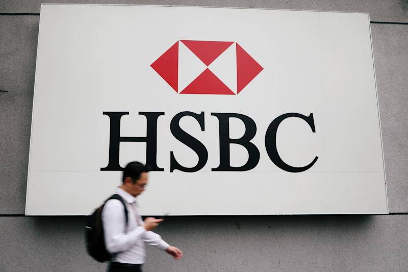 A man walks past a logo of HSBC at its headquarters in Kuala Lumpur, Malaysia August 6, 2019. Picture taken August 6, 2019. REUTERS/Lim Huey Teng