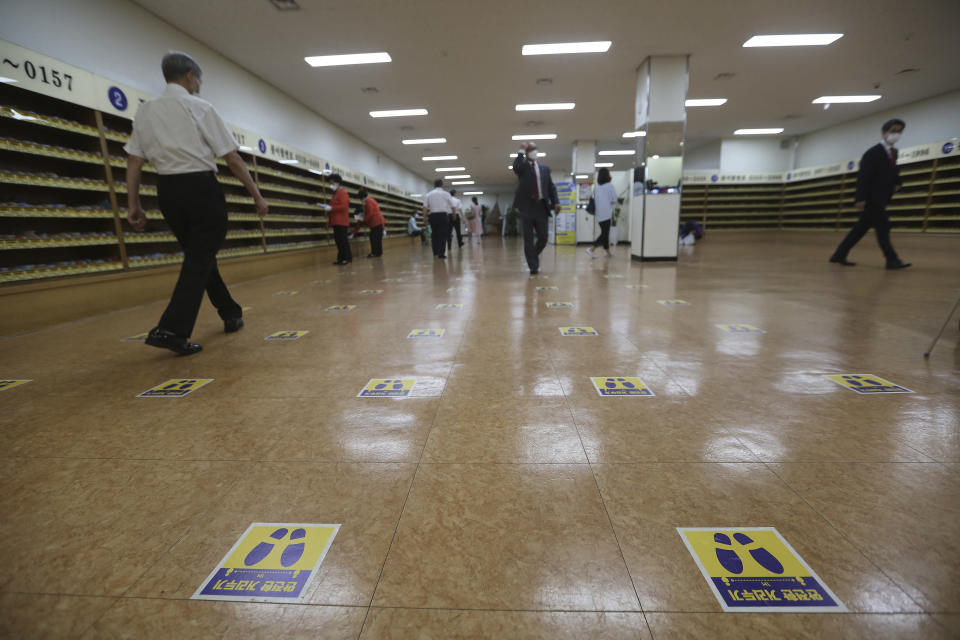 """Social distancing signs are seen on the floor for a service to help stop the spread of new coronavirus at the Yoido Full Gospel Church in Seoul, South Korea, Sunday, July 5, 2020. The signs read: """"Safe Distance."""" (AP Photo/Ahn Young-joon)"""