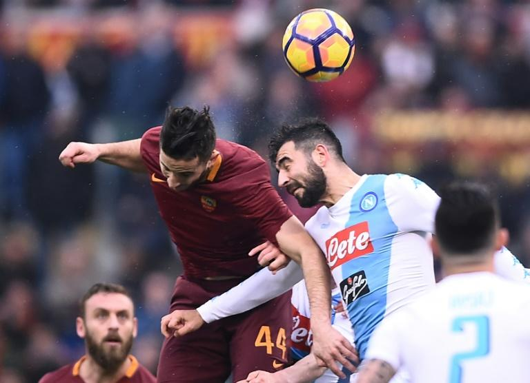 Roma's defender Kostas Manolas (L) fights for the ball with Napoli's defender Raul Albiol during the Italian Serie A football match March 4, 2017