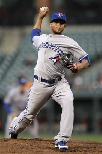 Toronto Blue Jays starting pitcher Henderson Alvarez throws against the Baltimore Orioles in the first inning of a baseball game in Baltimore, Tuesday, April 24, 2012. (AP Photo/Patrick Semansky)