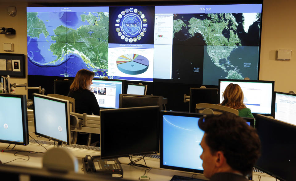 Department of Homeland Security workers at the National Cybersecurity and Communications Integration Center in Arlington, Va. (Larry Downing/Reuters)