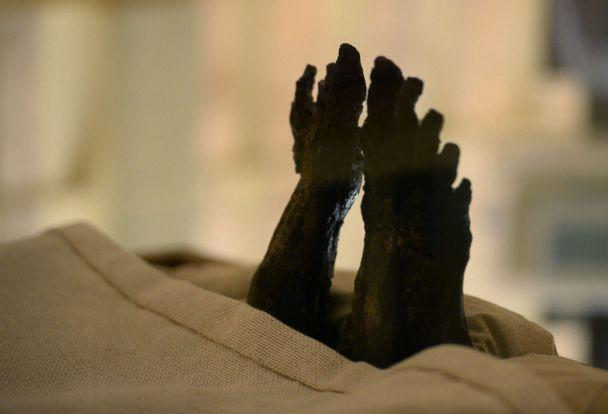 PHOTO: The feet of the linen-wrapped mummy of of the 18th dynasty Pharaoh Tutankhamun displayed in his climate-controlled glass case in his underground tomb in the Valley of the Kings on the west bank of the Nile river south of the capital Cairo. (Mohamed El-Shahed/AFP/Getty Images)