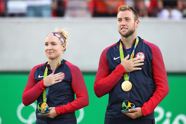 <p>Gold medalists Jack Sock and Bethanie Mattek-Sands of the United States pose on the podium during the ceremony for the mixed doubles on Day 9 of the Rio 2016 Olympic Games at the Olympic Tennis Centre on August 14, 2016 in Rio de Janeiro, Brazil. (Photo by Clive Brunskill/Getty Images) </p>