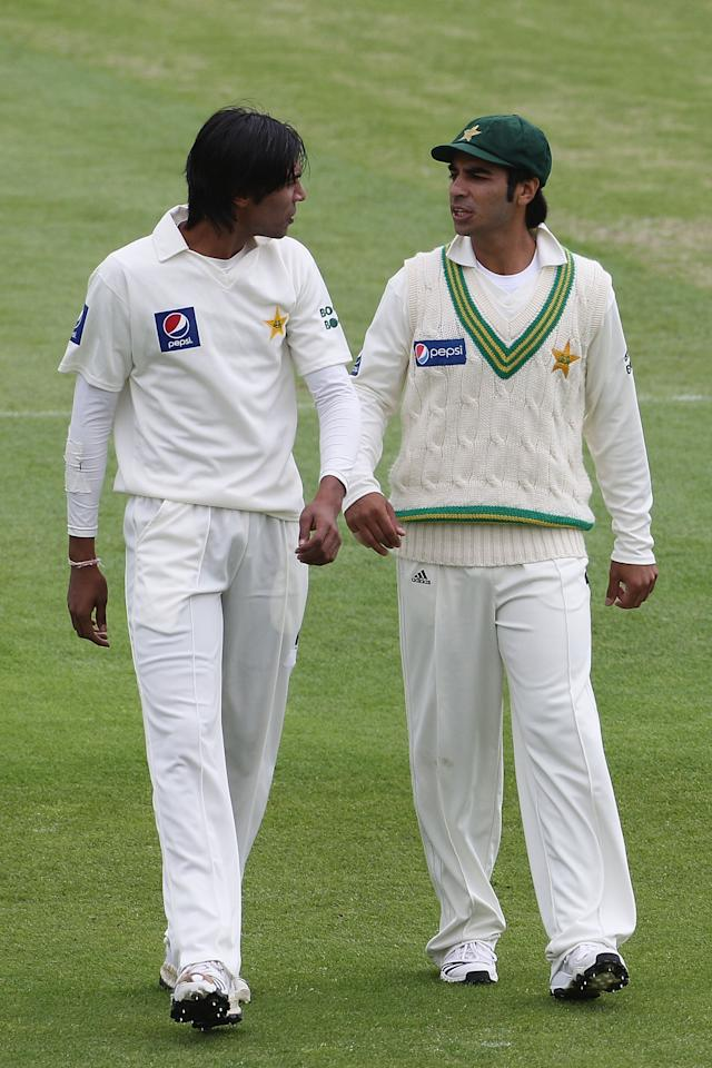 LEEDS, ENGLAND - JULY 21:  New Pakistan captain Salman Butt (R) speaks with team mate Mohammad Aamer during day one of the 2nd Test between Pakistan and Australia played at Headingley Carnegie Stadium on July 21, 2010 in Leeds, England.  (Photo by Hamish Blair/Getty Images)
