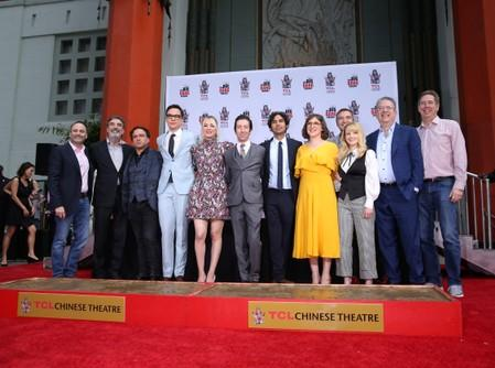 Executive producer and co-creator Chuck Lorre, actors Johnny Galecki, Jim Parsons, Kaley Cuoco, Simon Helberg, Kunal Nayyar, Mayim Bialik and Melissa Rauch pose with other producers during the cement handprints ceremony for the cast of the television comed