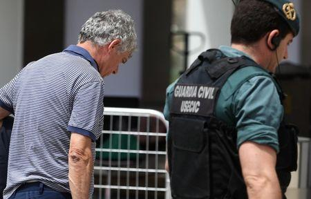 Spain's football federation (RFEF) president Angel Maria Villar is led by Spanish Civil Guards during a raid at the Spanish Soccer Federation headquarters in Las Rozas, outside Madrid, Spain, July 18, 2017. REUTERS/Juan Medina