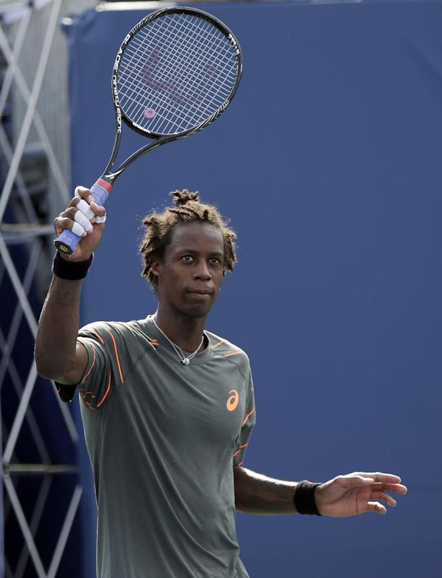 Gael Monfils, of France, holds up his racket after defeating Alexandr Dolgopolov, of Ukraine, 7-6 (11), 6-3 in the semifinals of the Winston-Salem Open tennis tournament in Winston-Salem, N.C., Friday, Aug. 23, 2013. (AP Photo/Chuck Burton)