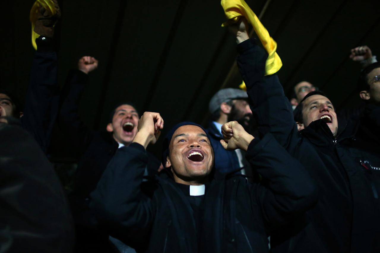 ROME, ITALY - MARCH 17:  Vatican seminarians and priests react as they watch the Clericus Cup overlooking St Peter's Basilica on March 17, 2013 in Rome, Italy. Vatican college Redemptoris Mater and Argentinian team Verbo Incarto played in the Clericus Cup as the Vatican prepares for the inauguration of Pope Francis on March 19, 2013 in St Peter's Square.  (Photo by Christopher Furlong/Getty Images)