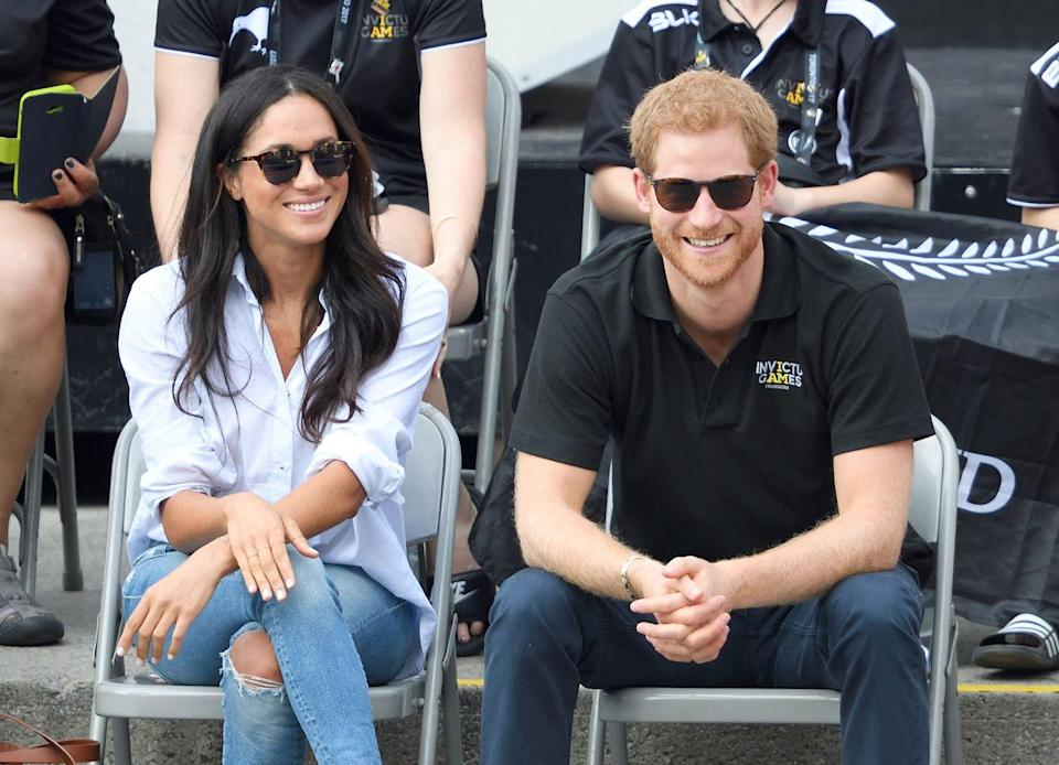 <p>Meghan sits with future-husband Prince Harry during wheelchair tennis on day three of the Invictus Games Toronto.</p>