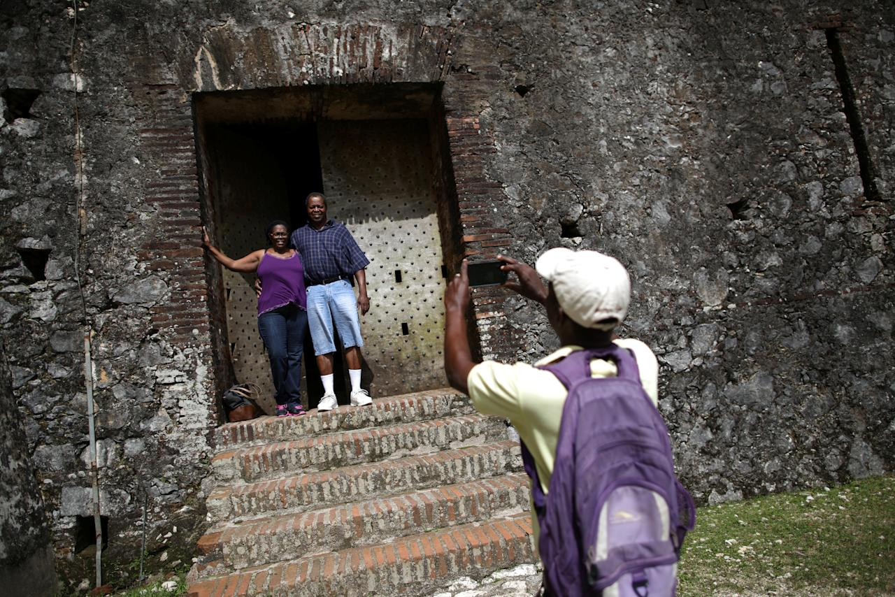 American tourists Janet Moore and Leonard Moore are photographed by a local guide as they visit the Citadel Laferriere in Milot, Haiti, November 19, 2017. The Citadel Laferriere is one of the main touristic attractions in Haiti and it is considered a World Heritage Site according to United Nations Educational, Scientific and Cultural Organization (UNESCO). REUTERS/Andres Martinez Casares