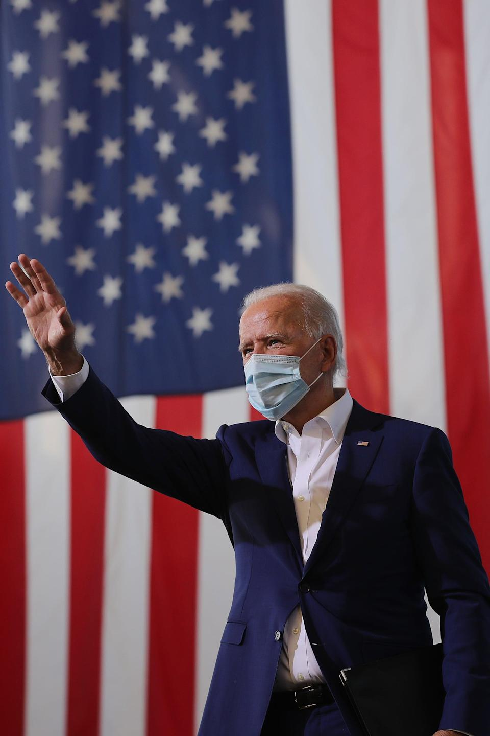 MIRAMAR, FLORIDA - OCTOBER 13: Wearing a face mask to reduce the risk posed by the coronavirus, Democratic presidential nominee Joe Biden waves to supporters during a drive-in voter mobilization event at Miramar Regional Park October 13, 2020 in Miramar, Florida. With three weeks until Election Day, Biden is campaigning in Florida. (Photo by Chip Somodevilla/Getty Images)