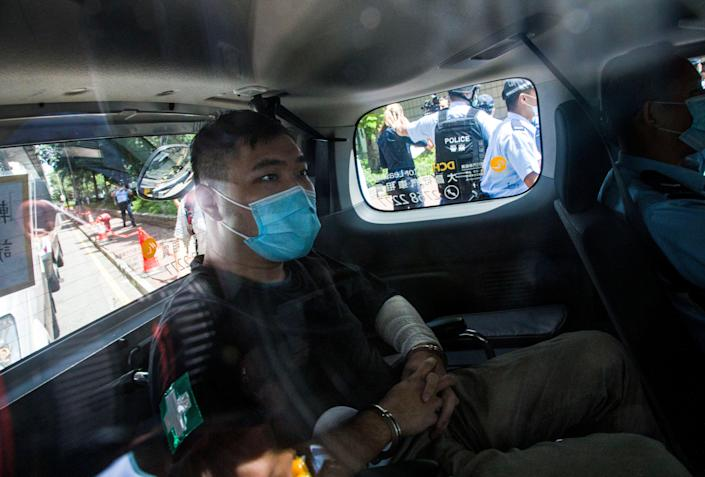File: Hong Kong defendant Tong Ying-Kit, 24, arrives at court after being accused of deliberately driving his motorcycle into a group of police officers last Wednesday on 6 July, 2020 (Getty Images)