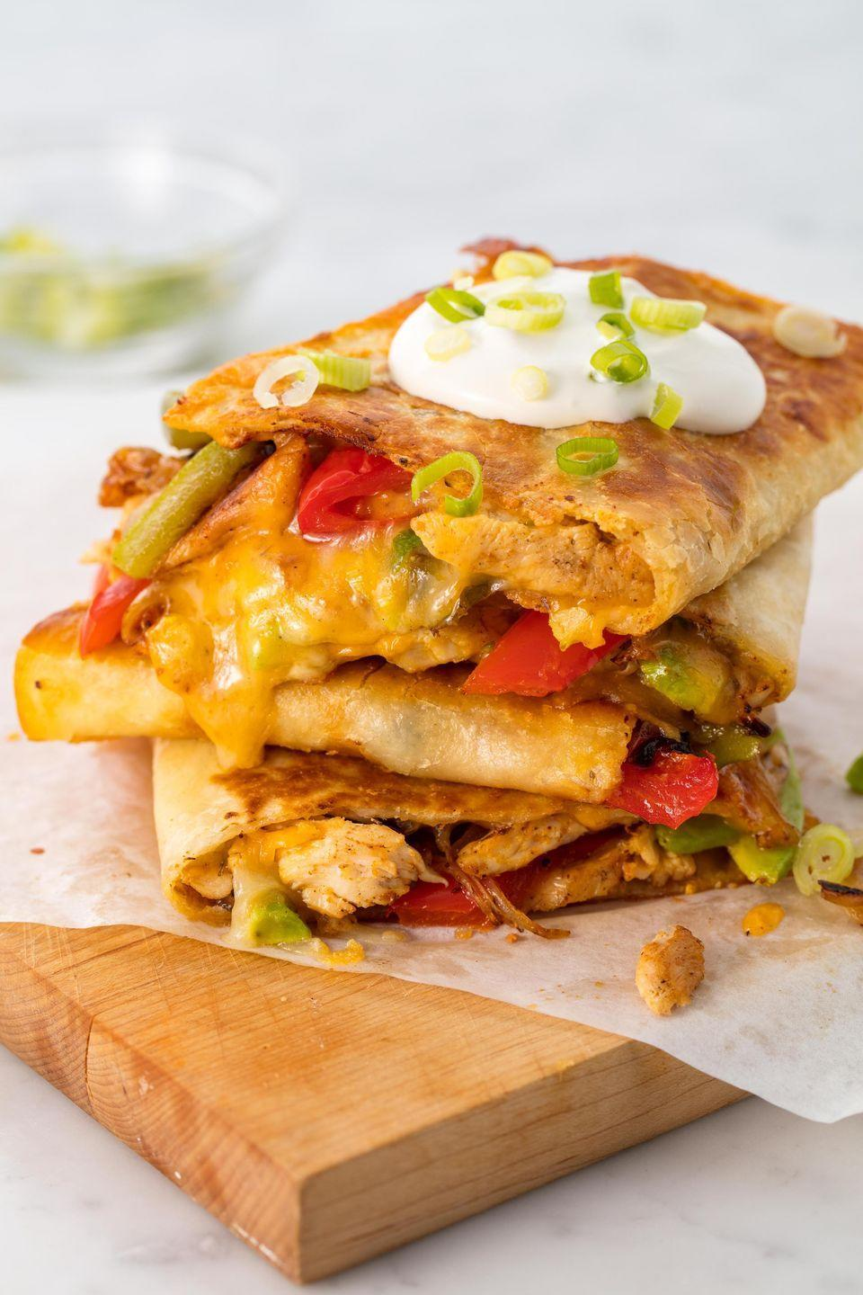 """<p>Start your weekend fiesta right.</p><p>Get the recipe from <a href=""""https://www.delish.com/cooking/recipe-ideas/recipes/a54465/easy-chicken-quesadilla-recipe/"""" rel=""""nofollow noopener"""" target=""""_blank"""" data-ylk=""""slk:Delish"""" class=""""link rapid-noclick-resp"""">Delish</a>. </p>"""