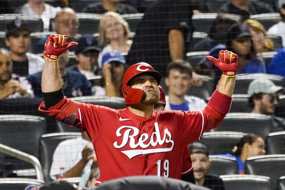 Cincinnati Reds' Joey Votto celebrates his solo home run in the sixth inning of the baseball game against the New York Mets, Friday, July 30, 2021, in New York. (AP Photo/Mary Altaffer)