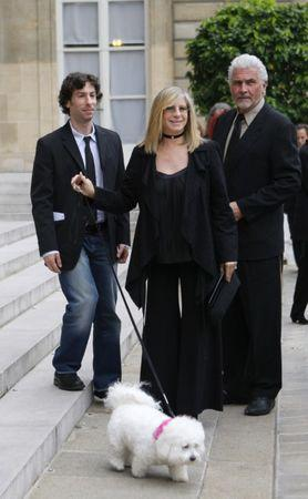 FILE PHOTO - U.S. actress Barbra Streisand (C) plays with her dog Samantha near her son Jason (L) and husband James Brolin as they arrive at the Elysee Palace in Paris June 28, 2007. REUTERS/Philippe Wojazer