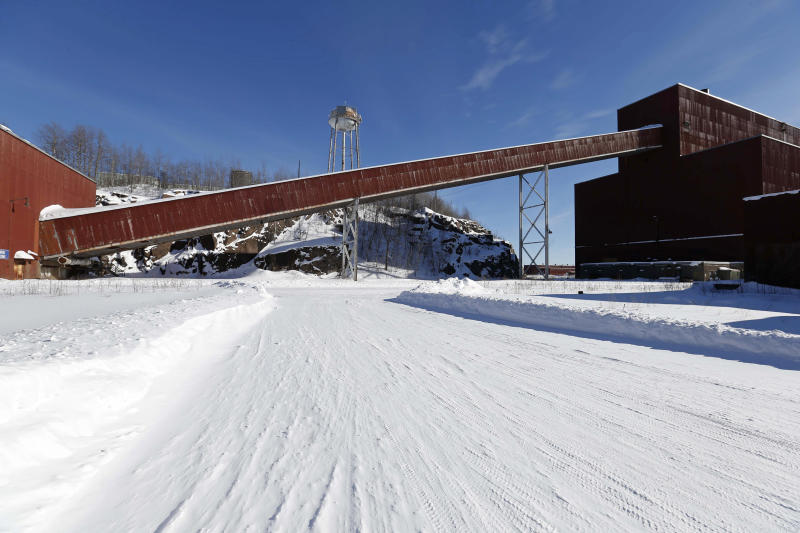 FILE - This Feb. 10, 2016, file photo, shows a former iron ore processing plant near Hoyt Lakes, Minn., that would become part of a proposed PolyMet copper-nickel mine. Environmental Protection Agency documents show that its staffers were critical of how Minnesota regulators drafted a key permit for the planned PolyMet copper-nickel mine. And they show the EPA officials concluded the permit would violate federal law because it lacked specific water pollution limits. The EPA released the documents after a court challenge by WaterLegacy. Environmental attorney Paula Maccabee says the EPA's concerns weren't reflected in PolyMet's final water pollution permit. (AP Photo/Jim Mone, File)
