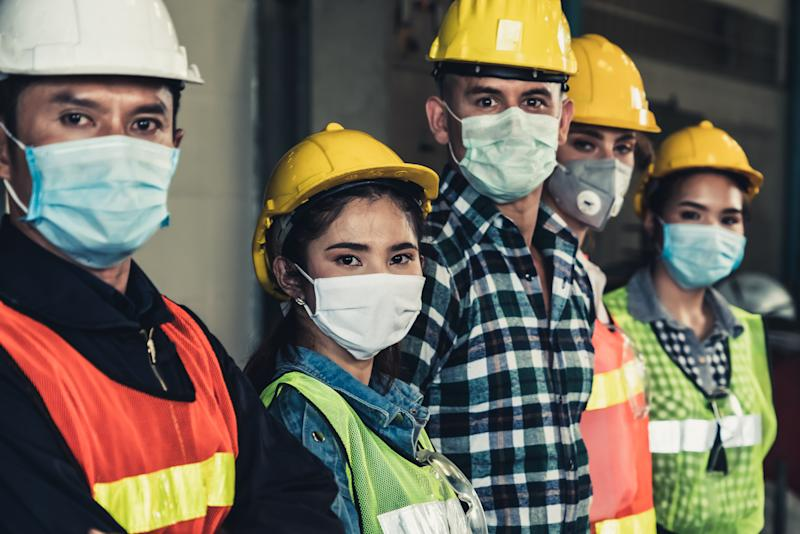 Factory workers with face mask protect from outbreak of the novel coronavirus, or COVID-19.