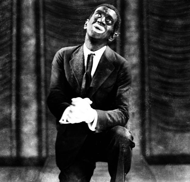 """FILE - This 1927 image originally released by Warner Bros., shows Al Jolson in blackface makeup in the movie """"The Jazz Singer."""" Historically, blackface emerged in the mid-19th century, representing a combination of put-down, fear and morbid fascination with black culture. Among the most prominent examples: Al Jolson and Eddie Cantor. Today, there's a fine line between mockery and tribute. (AP Photo/Warner Bros.)"""