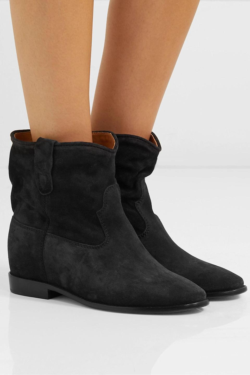 """<p><strong>Isabel Marant </strong></p><p>net-a-porter.com</p><p><strong>$680.00</strong></p><p><a href=""""https://go.redirectingat.com?id=74968X1596630&url=https%3A%2F%2Fwww.net-a-porter.com%2Fen-us%2Fshop%2Fproduct%2Fisabel-marant%2Fshoes%2Fankle%2Fcrisi-suede-ankle-boots%2F8378037991351528&sref=https%3A%2F%2Fwww.townandcountrymag.com%2Fstyle%2Ffashion-trends%2Fg28225508%2Ffall-boots%2F"""" rel=""""nofollow noopener"""" target=""""_blank"""" data-ylk=""""slk:Shop Now"""" class=""""link rapid-noclick-resp"""">Shop Now</a></p><p>It doesn't get much more effortlessly undone and French than Isabel Marant's Crisi booties. And for those who like a little extra height from their shoes: fear not, these have an interior wedge heel for just a smidge more lift. </p>"""