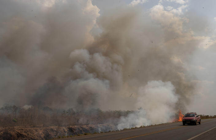 Fire consumes a field along the BR 070 highway near Cuiaba, Mato Grosso state, Brazil, Aug. 25, 2019. Experts say most of the fires are set by farmers or ranchers clearing existing farmland, but the same monitoring agency has reported a sharp increase in deforestation this year as well. (Photo: Andre Penner/AP)