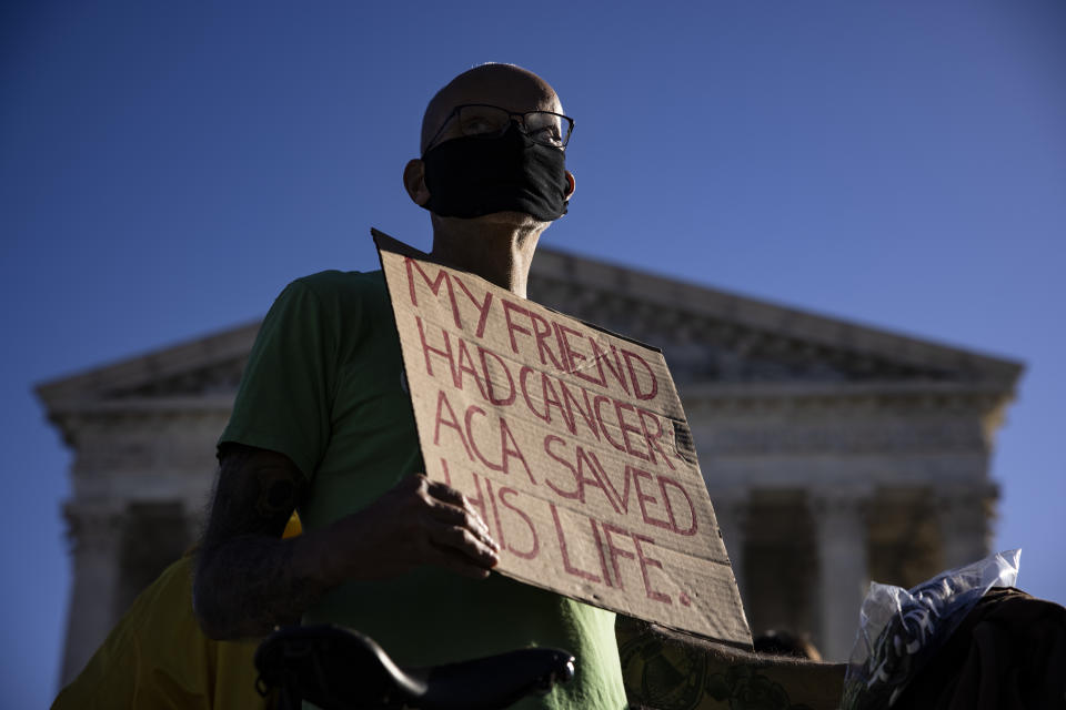 A supporter of the Affordable Care Act (ACA) stands in front of the Supreme Court of the United States as the Court begins hearing arguments from California v. Texas about the legality of the ACA on November 10, 2020 in Washington, DC. (Samuel Corum/Getty Images)